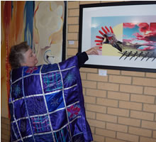 Marlene Greenwood looking at Jennifer Phillips art