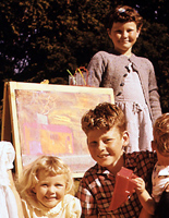early photo of Phillips with her easel showing her sister's chalk drawing